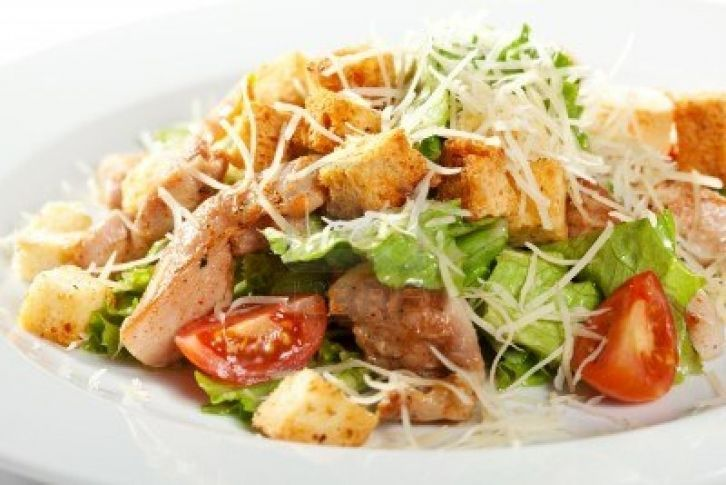 Caesar salad with grilled chicken breast.